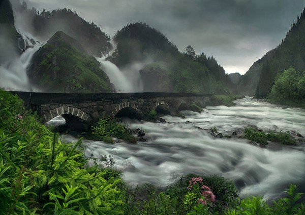 Arched bridge over Latefossen waterfall, Norway
