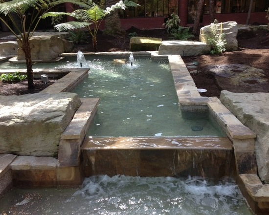 Fountain decorated with a coarse natural stone
